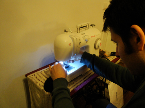 Nissim Schaul sewing the BB-sock piano mutes shut